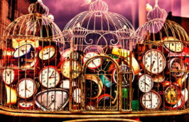 Old antique retro clocks in iron cage. Collection of vintage